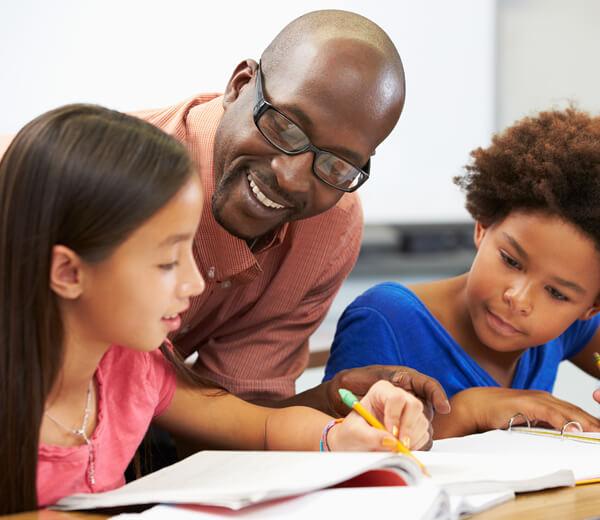 teacher overlooking students working