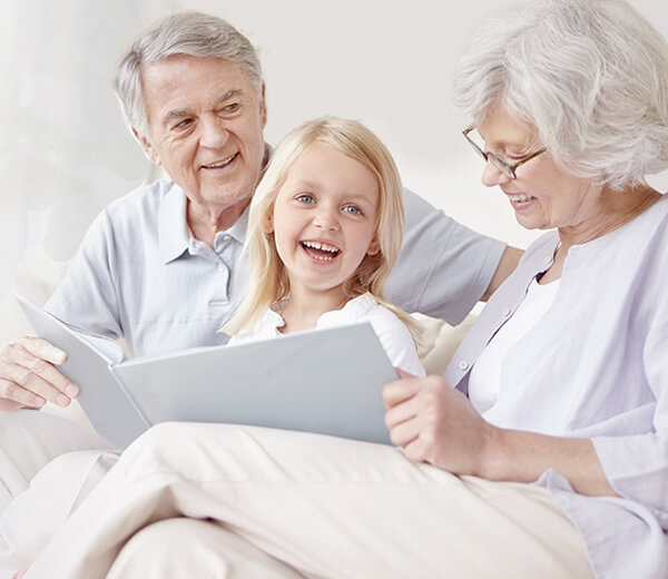 grandparents reading to grandchild